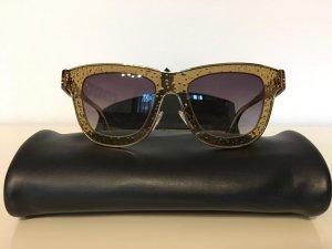 Balenciaga Gafas de sol ovaladas color oro