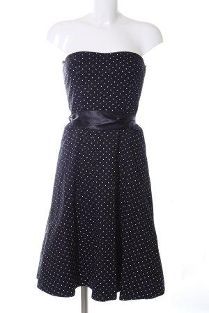 Bandeaujurk zwart-wit gestippeld patroon Jaren 50 stijl