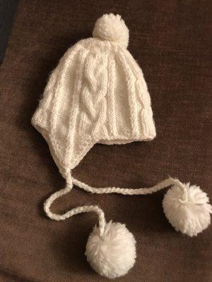 Barts weiße Mütze mit Bommeln