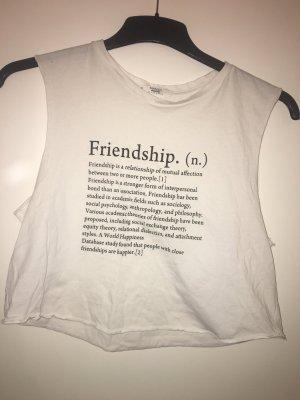 Bauchfreies top in weiß mit der Aufschrift friendship