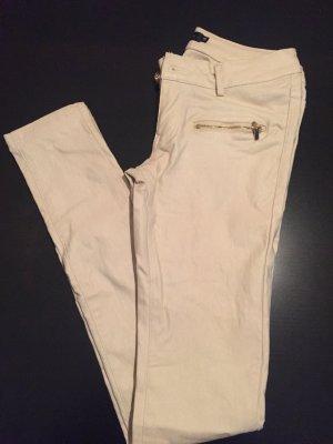 Beige beschichtete skinny Jeans der Trend in lederoptik