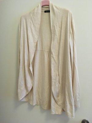 Joe Taft Smanicato lavorato a maglia crema