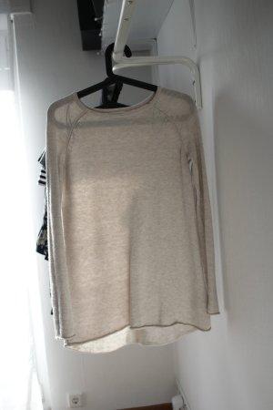 Beiger, längerer Pullover