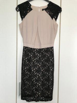 Beiges Kleid mit schwarzer Spitze