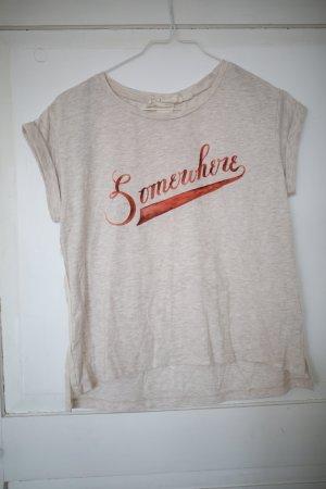 Beiges T-Shirt mit Schriftzug
