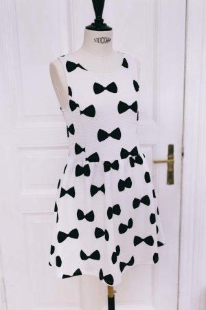 beliebtes Trägerkleid mit Schleifenmuster von H&M
