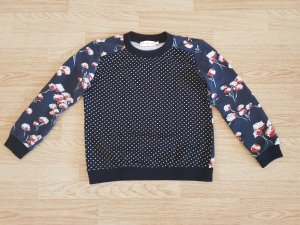 Besonderer Sweater von Tory Burch
