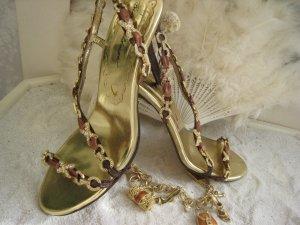 Beverly Feldman Sandalias de tacón alto color oro Cuero