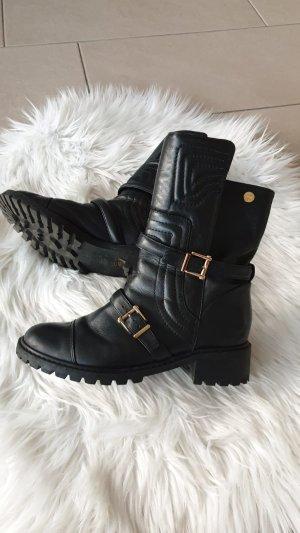 Borceguíes negro-color oro
