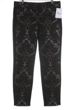 Blacky Dress Pantalón tipo suéter negro-color oro estampado floral