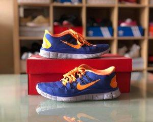 Blau/ Orangene Nike Free Laufschuhe 37,5