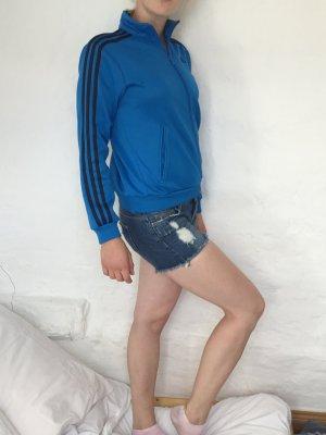 Blaue Addidad Jacke mit schwarzen Streifen