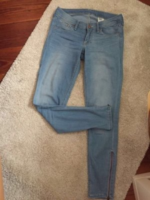 Blaue Skinny Jeans mit Reißverschluss am Knöchel Gr. 28