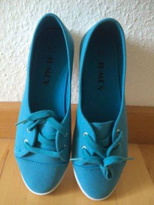 Blaue Sneaker von Jumex