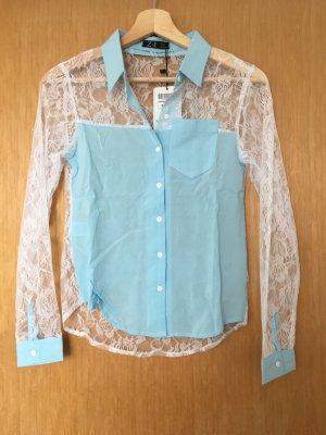 Blusa in merletto multicolore