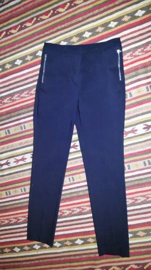blaue Stretchhose mit seitlichen Reißverschlüssen