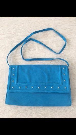 Blaue Tasche von H&M mit goldenen Nieten