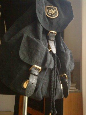 blauer Stoffrucksack mit goldenen Details