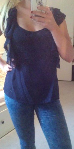 Blaues Volanttop mit Rückenausschnitt
