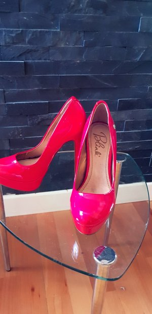 Blink Platform Pumps red