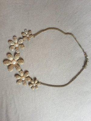Collar color oro-blanco