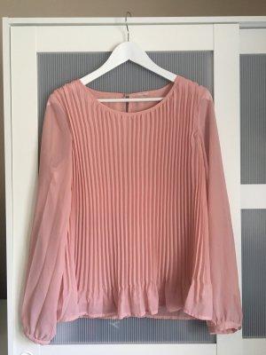Blusa brillante color rosa dorado