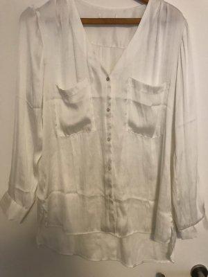 Glanzende blouse wolwit