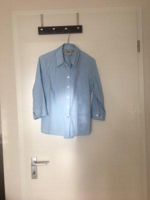 Blusa in lino azzurro
