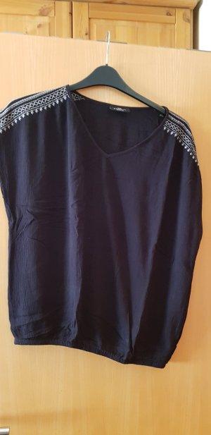 Bluse aus Crepe in schwarz