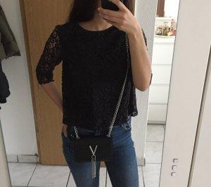 Bluse aus Spitze mit Knopfleiste am Rücken