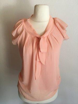 Blouse à volants rose chair-abricot
