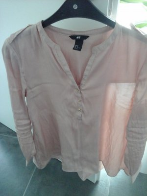Blusa brillante color oro rosa