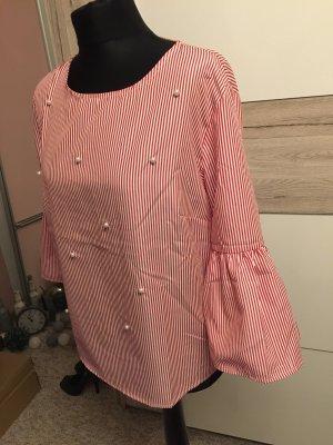 Blusa con volantes rosa-rosa claro