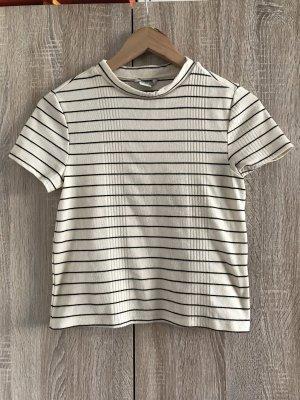 Mouwloze blouse zwart-licht beige