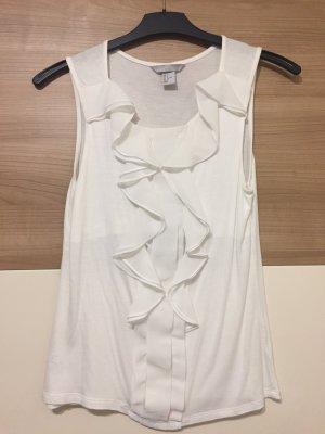Bluse in weiß am Brustbereich mit Top darunter .