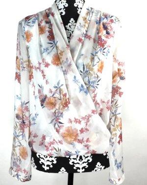 Bluse mit floramen Muster von H&M tragbar für Gr. 34 und 36 !!!!!