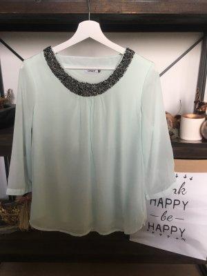 Bluse mit perlenbesticktem Kragen