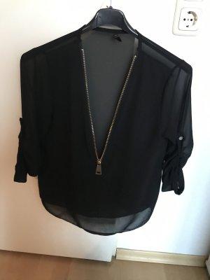 Blusa de seda negro