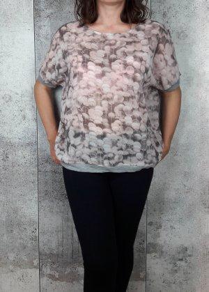 Bluse mit Rückenausschnitt in einem zarten rosa