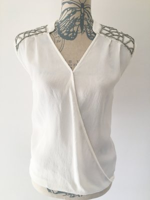 Bluse mit Silberapplikationen am Schulter