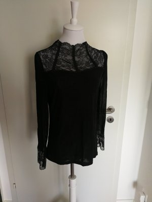 Blusa in merletto nero