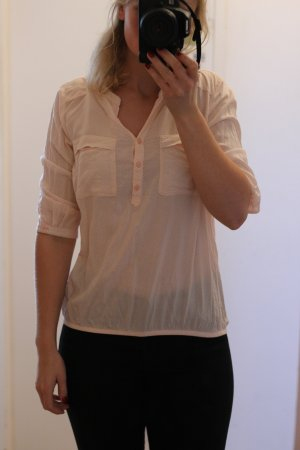 Bluse mit weißen Pünktchen