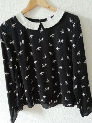 Bluse mit weißen Vögeln