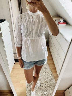 Blusa de cuello alto blanco