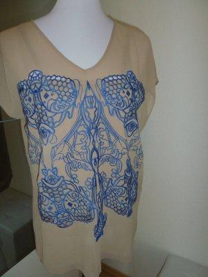 Bluse und Top mit Stickerei