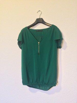 Blusenshirt in leuchtend-sattem Grün mit goldenem Reißverschluss