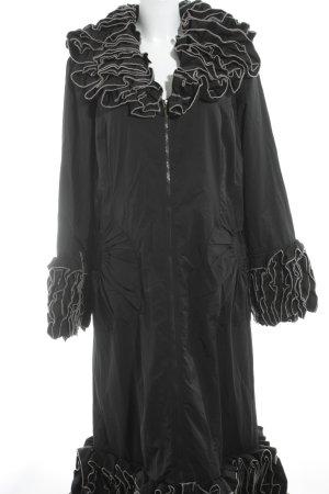bodenlanger Mantel schwarz-creme extravaganter Stil
