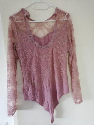 Blusa tipo body color rosa dorado