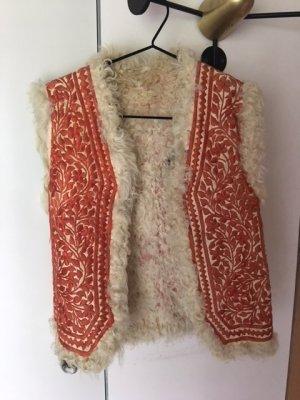 Smanicato di pelliccia rosso chiaro-crema