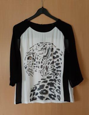 Bonita Blusa con lazo negro-blanco puro